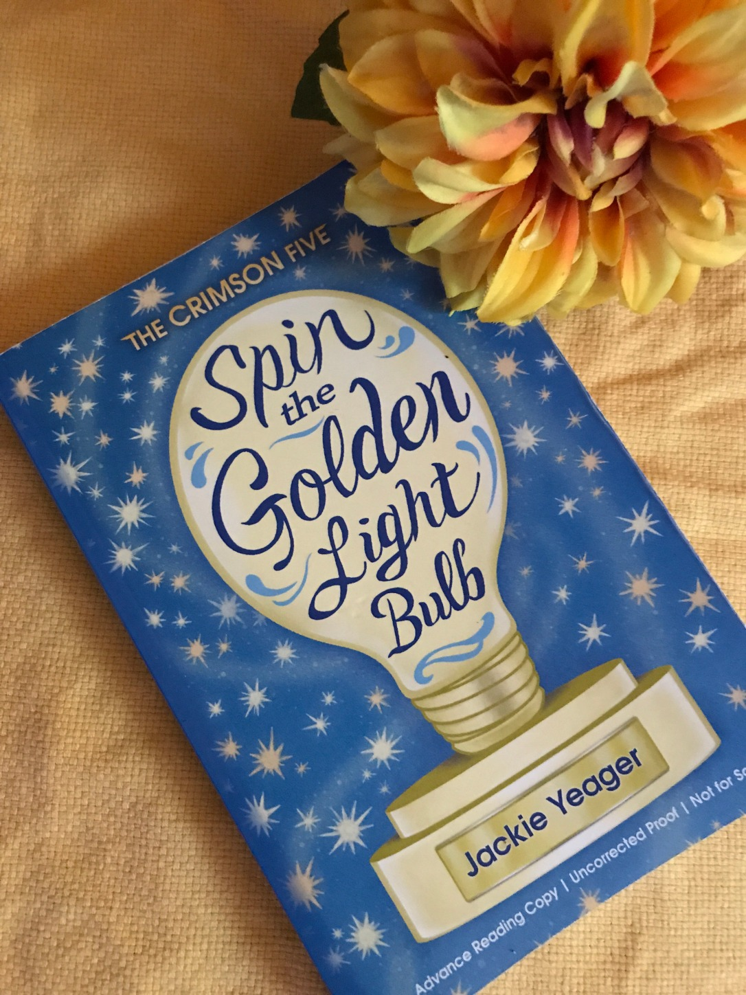 Spin the Golden Light Bulb with yellow flower