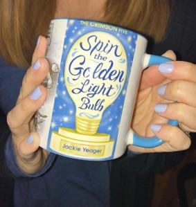 Holding STGLB mug